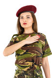 Young woman soldier in military camouflage outfit Stock Photos