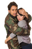 Young woman and soldier in military uniform say Stock Photography