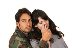 Young woman and soldier in military uniform say Stock Photos