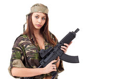 Young woman soldiers with guns Stock Photos