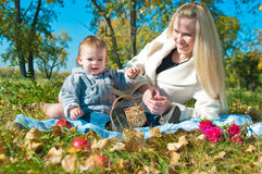 The young woman with the son on walk royalty free stock photography