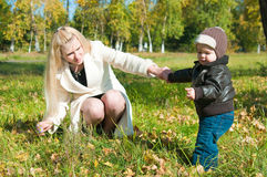 The young woman with the son on walk Stock Photos