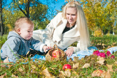 The young woman with the son on walk Stock Photography