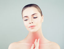 Young Woman with a Sore Throat. Woman Puts Hands on the Neck Stock Photography