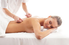 A young woman on a spa back massage Stock Photography