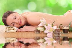 Young woman in a spa. Beautiful young woman in a spa royalty free stock images