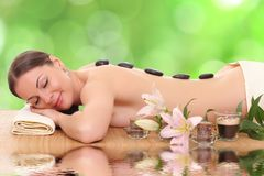 Young woman in a spa. Beautiful young woman in a spa royalty free stock photos