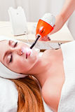 Young woman in spa clinic Stock Photography