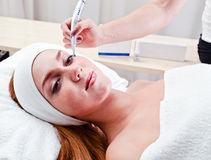 Young woman in spa clinic Stock Photo