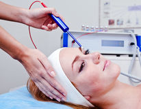 Young woman in spa clinic Stock Images