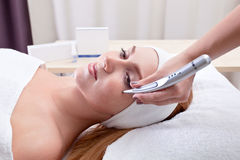 Young woman in spa clinic Stock Image