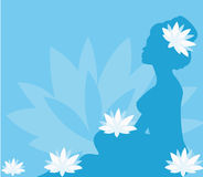 Young woman in spa with lotus blooms. On blue background Royalty Free Stock Image