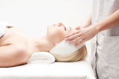 A young woman on a spa massage procedure Stock Image