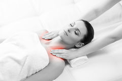 Young woman on a spa massage procedure. Healthy Beautiful Woman Spa. Recreation Energy Health Massage Healing Concept royalty free stock photo
