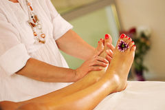 Young woman in Spa massage salon legs feet Royalty Free Stock Images