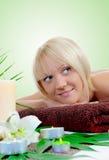 Young woman at spa procedure Stock Photos