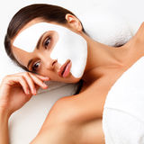 Young Woman at Spa Salon With Cosmetic Mask on Face. Stock Photography