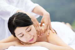 Young woman in spa salon getting massage Stock Images