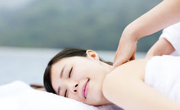 Young woman in spa salon getting massage Stock Photos