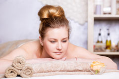 Young woman at spa salon. Spa Treatment. Pretty Woman Getting Spa Treatment in Spa Salon,  Closeup Stock Photo