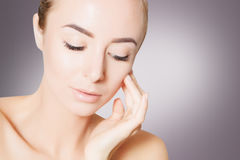 Young woman spa skin concept, photo over grey background Royalty Free Stock Photo