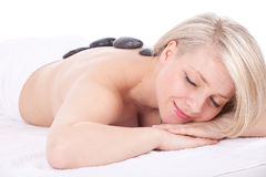 Young woman in spa, stones massage Royalty Free Stock Photo