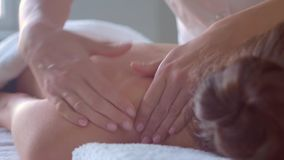 Young woman in spa. Traditional healing therapy and massaging treatments. Health, skin care, massage, osteopathy and stock video