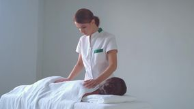 Young woman in spa. Traditional healing therapy and massaging treatments. Health, skin care, massage, osteopathy and stock video footage