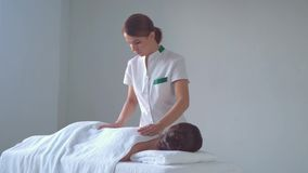 Young woman in spa. Traditional healing therapy and massaging treatments. Health, skin care, massage, osteopathy and stock footage