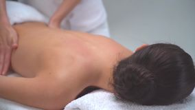 Young woman in spa. Traditional healing therapy and massaging treatments. Health and skin care, massage and recreation stock footage