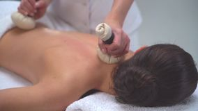 Young woman in spa. Traditional healing therapy and massaging treatments. Health and skin care, massage and recreation stock video