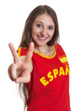 Young woman from Spain showing victory sign Royalty Free Stock Photo