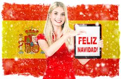Young woman spainish national flag Merry Christmas Feliz Navidad royalty free illustration
