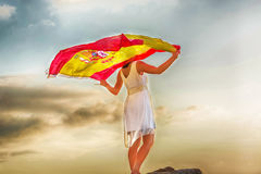 Young Woman with Spanish flag. In front of dramatic sky Stock Images
