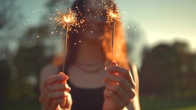 A young woman with a sparkler stock footage