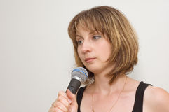 Young woman-speaker Stock Photography