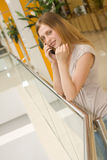 Young  woman speaking on cellphone in the mall Stock Photos