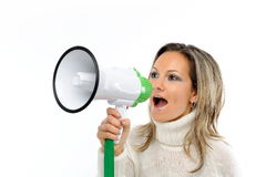 Young woman speaking through megaphone Stock Photography