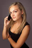 Young woman speaking on the mobile Royalty Free Stock Images