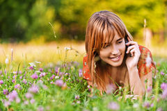 Young woman speaking on phone royalty free stock photo