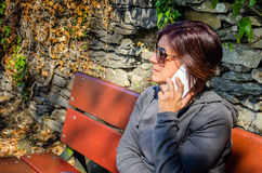 Young Woman Speaking on the Phone Royalty Free Stock Image