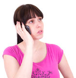 Young the woman speaks by a mobile phone. Isolated Royalty Free Stock Photo
