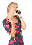 Young woman speaks by a mobile phone. White background Royalty Free Stock Image