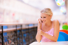 Young woman speaks by phone Royalty Free Stock Image