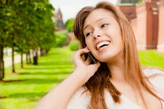 Young woman speaks by phone Royalty Free Stock Images