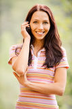 Young woman speaks by phone Royalty Free Stock Photo