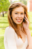 Young woman speaks by phone Stock Photography