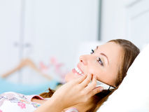 Young woman speaks on the phone royalty free stock photography