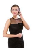 Young woman speaks on phone Royalty Free Stock Photography