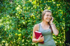 Young woman speaks by phone Stock Images